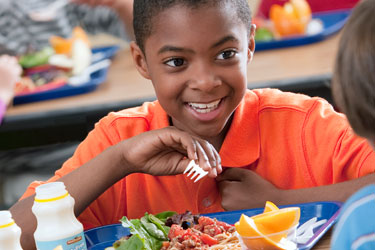 Photo of student eating lunch as part of National School Lunch Program