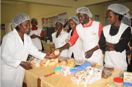 Feed the Future Innovation Lab for Food Processing and Post-Harvest Handling (FPIL) led by Purdue University Professor Violet Mugalavai and students with products from FPIL research (photo: University of Eldoret)