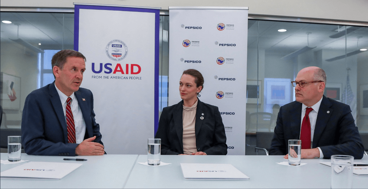 USAID Administrator Mark Green signs an agreement with PepsiCo that expands the Feed the Future initiative to combat global hunger.